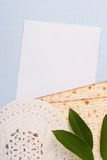 Jewish symbols. A white kippah and matzah next to a white piece of paper. Add your text to the paper Stock Image