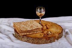 Passover holiday concept with wine and matzoh over rustic background with copy space. Jewish symbols for the Passover holiday concept with wine and matzoh over Royalty Free Stock Photos