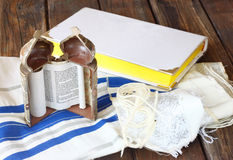 Jewish torah and talit on wooden table Royalty Free Stock Photography
