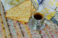 Jewish traditional Passover unleavened bread and a wine cup with the text of the traditional wine blessing. Blessed is the fruit of vine Royalty Free Stock Photography