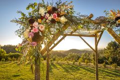 Jewish traditions wedding ceremony. Wedding canopy chuppah or huppah decorated with flowers. Outdoor sunset view of a Jewish traditions wedding ceremony. Wedding Stock Images
