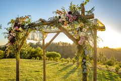 Jewish traditions wedding ceremony. Wedding canopy chuppah or huppah with golden light. Outdoor sunset view of a Jewish traditions wedding ceremony. Wedding Royalty Free Stock Images