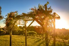 Jewish traditions wedding ceremony. Wedding canopy chuppah or huppah with lens flare. Outdoor sunset view of a Jewish traditions wedding ceremony. Wedding canopy Stock Photos