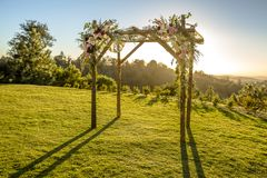 Jewish traditions wedding ceremony. Wedding canopy chuppah or huppah outside on the lawn. Outdoor sunset view of a Jewish traditions wedding ceremony. Wedding Stock Image