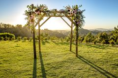 Jewish traditions wedding ceremony. Wedding canopy chuppah or huppah with the sun behind it. Outdoor sunset view of a Jewish traditions wedding ceremony. Wedding Stock Photos