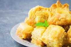 Jewish, turkish, arabic traditional national dessert. Macro. Selective focus. Baklava with honey and nuts. Jewish, turkish, arabic traditional national dessert Royalty Free Stock Photos