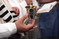 Jewish Wedding Ceremony. Rabbi holds silver kiddish cup with wine Royalty Free Stock Images