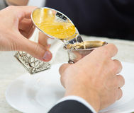 Jewish wedding. 2 silver glasses. Traditional ceremonies at a Jewish wedding, after a prayer after the meal and said seven blessings pour wine from one glass to Stock Images