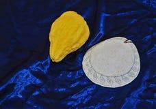 Jewish  white skullcap on blue velvet. Jewish holiday of Sukkot. Ritual fruit - etrog and  white skullcap on blue velvet Stock Photography