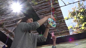 Jewish woman and child decorating their family Sukkah for the Jewish festival of Sukko stock video footage