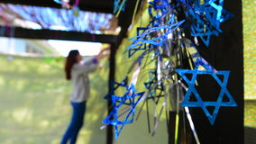Jewish woman decorating here family Sukkah for the Jewish festival of Sukkot stock video