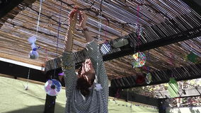 Jewish woman decorating here family Sukkah for the Jewish festival of Sukkot stock footage