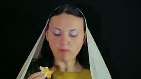 A Jewish woman dips a date in honey in honor of Rosh Hashanah and tries. stock footage