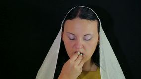 A Jewish woman is eating a date in honey in honor of Rosh Hashanah. stock video