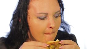 Jewish woman eats chicken in a cafe with a crisp stock video