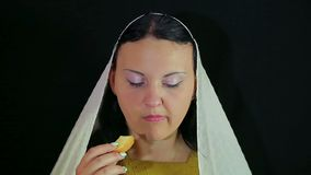 A Jewish woman eats a piece of apple in honey in honor of Rosh Hashanah. stock video footage