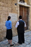 Jewish woman and a Jew read the inscription on the wall Royalty Free Stock Image