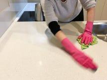 Jewish woman Koshering her new home kitchen Stock Images