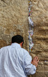 Jewish worshiper pray at the Wailing Wall. Royalty Free Stock Photos