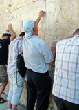 Jewish worshipers pray at the Wailing Wall Stock Image