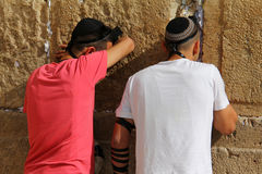 Jewish worshipers pray at the Wailing Wall an important jewish religious site   in Jerusalem, Israel. Stock Photo