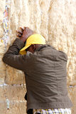 Jewish worshipers pray at the Wailing Wall an important jewish religious site   in Jerusalem, Israel. Royalty Free Stock Images