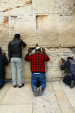 Jewish worshipers pray at the Wailing Wall Stock Images