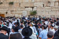 Jewish worshipers in white shawls Stock Photos