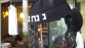 Jewish yarmulke on a market. Black Jewish yarmulke with sodelocks stock video