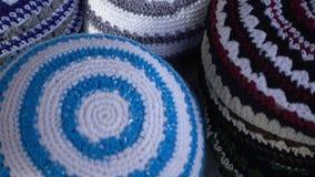Jewish yarmulke on market. Jewish yarmulke - variety of colors on the market stock video footage