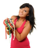 Jewlery. Young woman with jewlery isolated on white royalty free stock photography