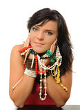 Jewlery. Young woman with jewlery isolated on white royalty free stock images
