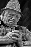 Jews harp maker. Unidentified old man makes a jews harp in Bucovina, Romania. Black and White photo Royalty Free Stock Photo