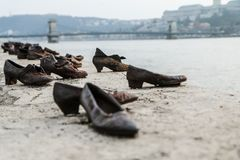 Jews murder memorial by Danube in Budapest. A memorial remembering the murder of the jews during second world war. Standing by the river Danube in Budapest Royalty Free Stock Photo