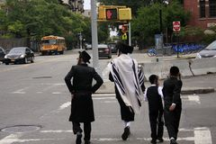 Jews in New York. New York, United States - 3 September 2016. People walking in Jewish religious clothing in the street of Jewish district in Williamsburg Royalty Free Stock Photography