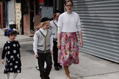 Jews in New York. New York, USA - 3 September 2016 - Jewish people walking in the street of Williamsburg stock photos