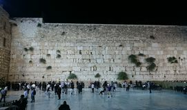 Jews Praying at the Western Wall at Night Stock Images