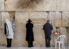 Jews worship at the stones of  the Western Wall Stock Images