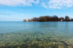 Jezioro i latarnia morska Obrazy Royalty Free