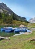 Jezioro i łodzie w górach Obraz Stock