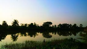 Jezioro i zmierzchy Fotografia Royalty Free