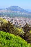Jezreel Valley, biblical Mount Tabor and the Arab villages, Galilee, Israel. View of the Jezreel Valley, biblical Mount Tabor and the Arab villages at its foot royalty free stock image
