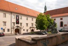 Jezuitski Square, Klovic Palace and Fisherman With Snake statue Stock Image