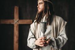 Jezus Chrystus trzyma filiżankę wino zdjęcia stock
