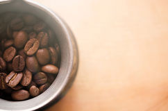 Jezve with coffee beans on wood background Stock Photography