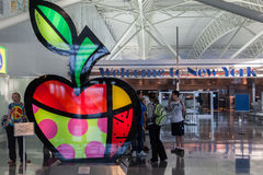 JFK Airport New York City. A big colorful apple by Romero Britto and a sign of Welcome to New York inside the JFK John F. Kennedy airport in New York City with Royalty Free Stock Photo