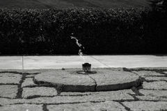 JFK`s Eternal Flame. JFK`s Tomb at Arlington National Cemetery in Washington D.C. with a main focus on his Eternal Flame stock photos