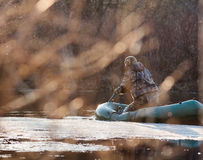 Jäger auf dem Boot Stockbilder
