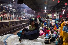 JHANSI, INDIA - 10 NOVEMBER 2017: Unidentified Indians wait for train in Jhansi. JHANSI, INDIA - MARCH 3: Unidentified Indian people at Jhansi railway station stock photography