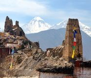 Jhong village and mount Dhaulagiri. Jhong village, one of the best villages in round Annapurna circuit trekking trail route, Nepal Himalayas mountains royalty free stock image